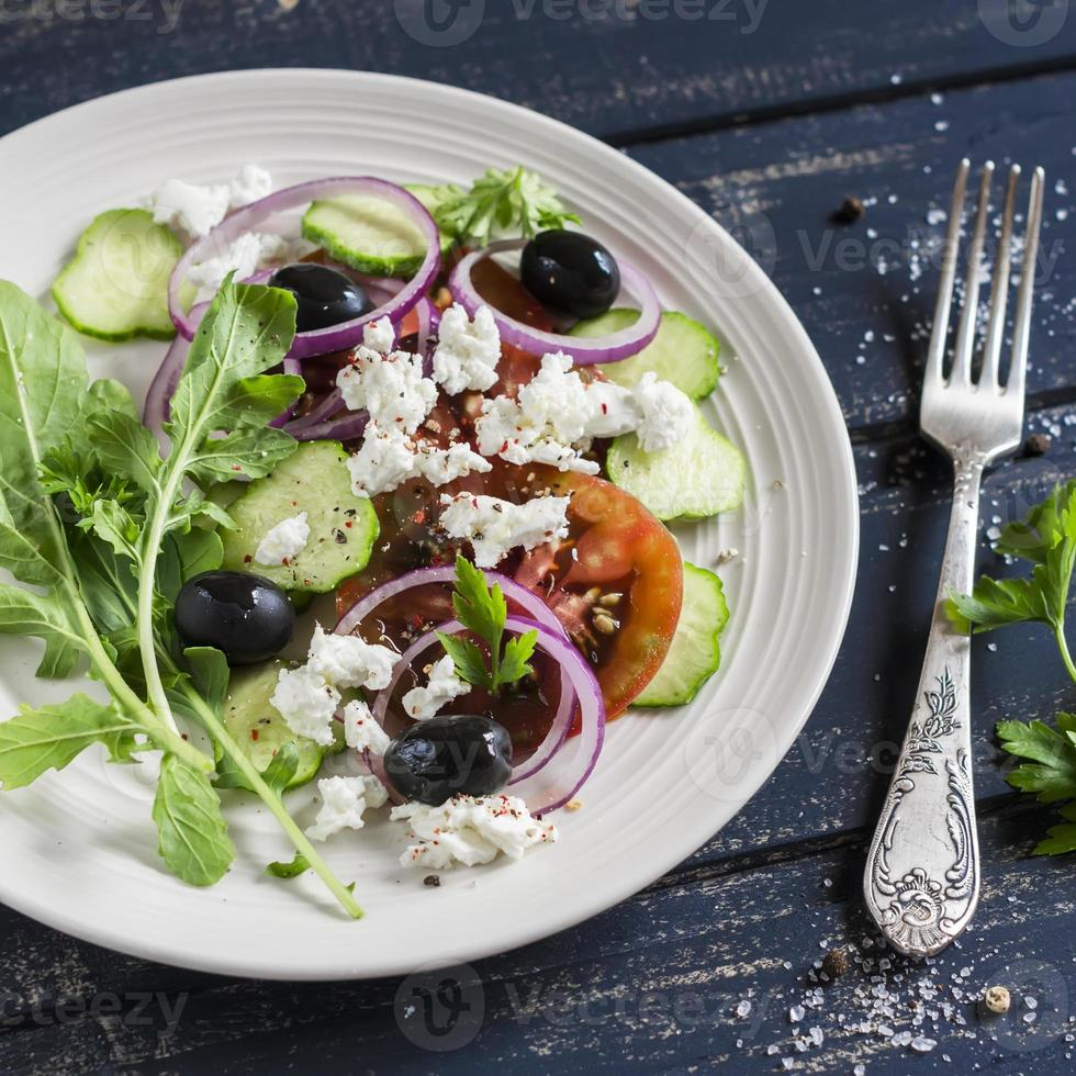 salad with tomatoes, cucumbers, olives and feta cheese photo