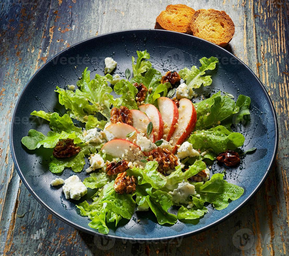 Fresh salad with pear, walnuts and blue cheese photo