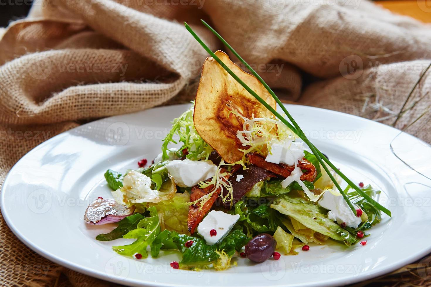 Fresh spring salad with feta cheese, red onion in white photo