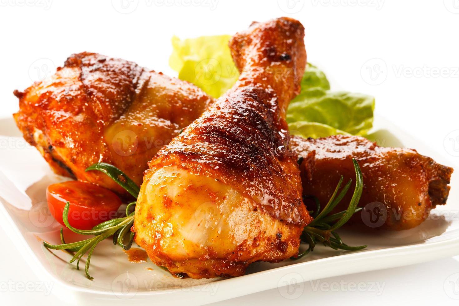 Roasted chicken legs photo
