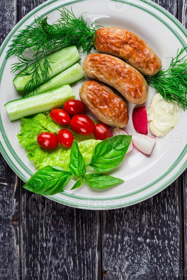 Sausages and vegetables photo