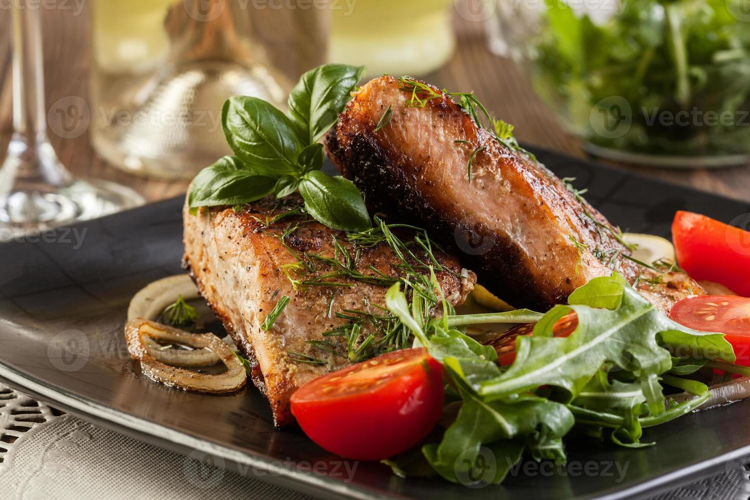 Fried salmon steak with vegetables photo