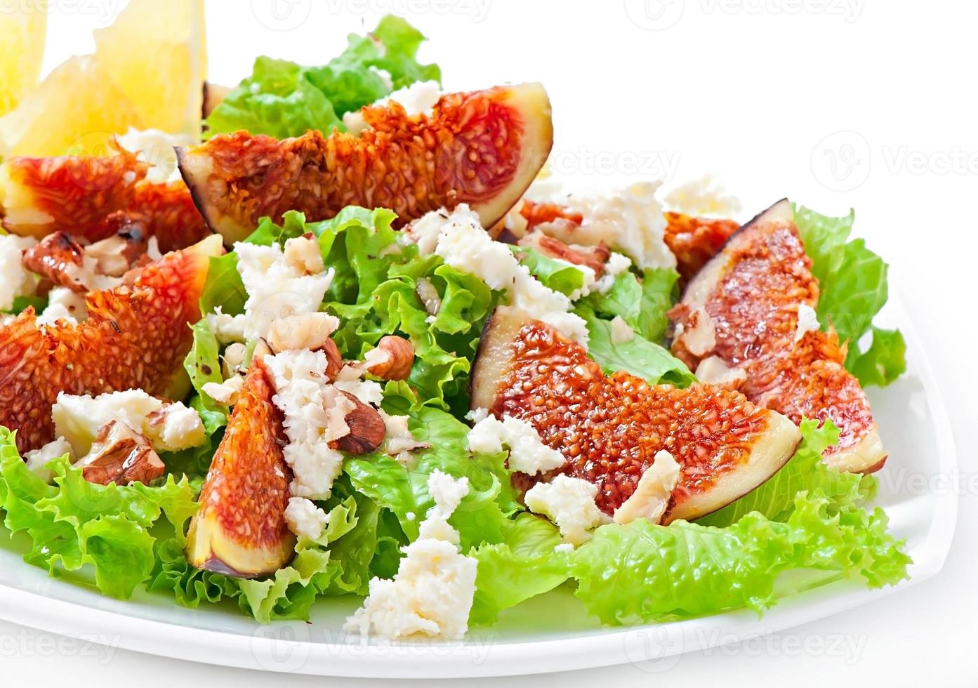 Green salad with figs, cheese and walnuts photo