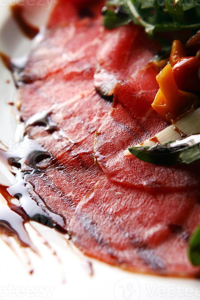 Beef carpaccio served with ruccola photo