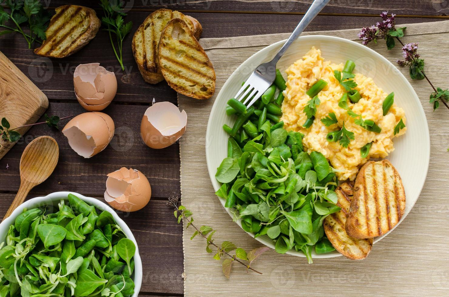 Scrambled eggs with salad photo