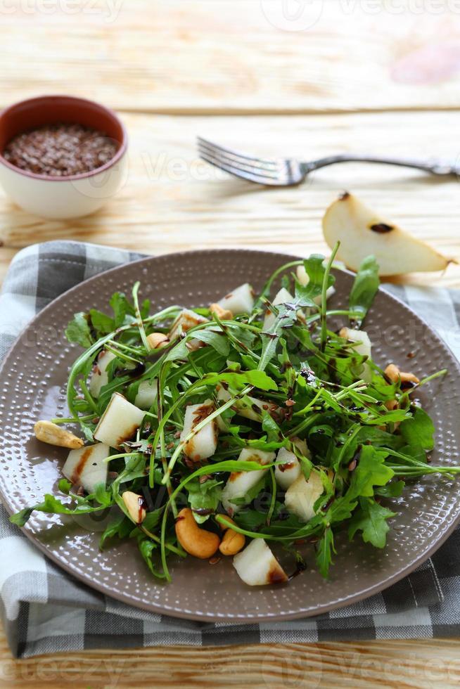juicy fresh salad with arugula and pear photo