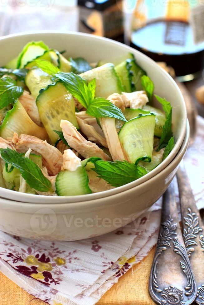 Oriental salad with cucumber and chichen photo