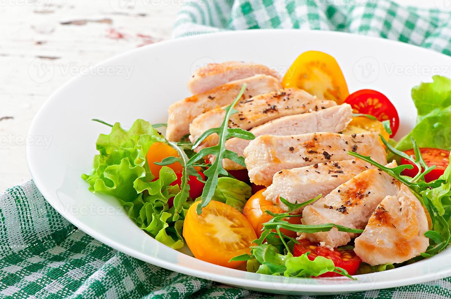 Grilled chicken breasts and fresh salad photo