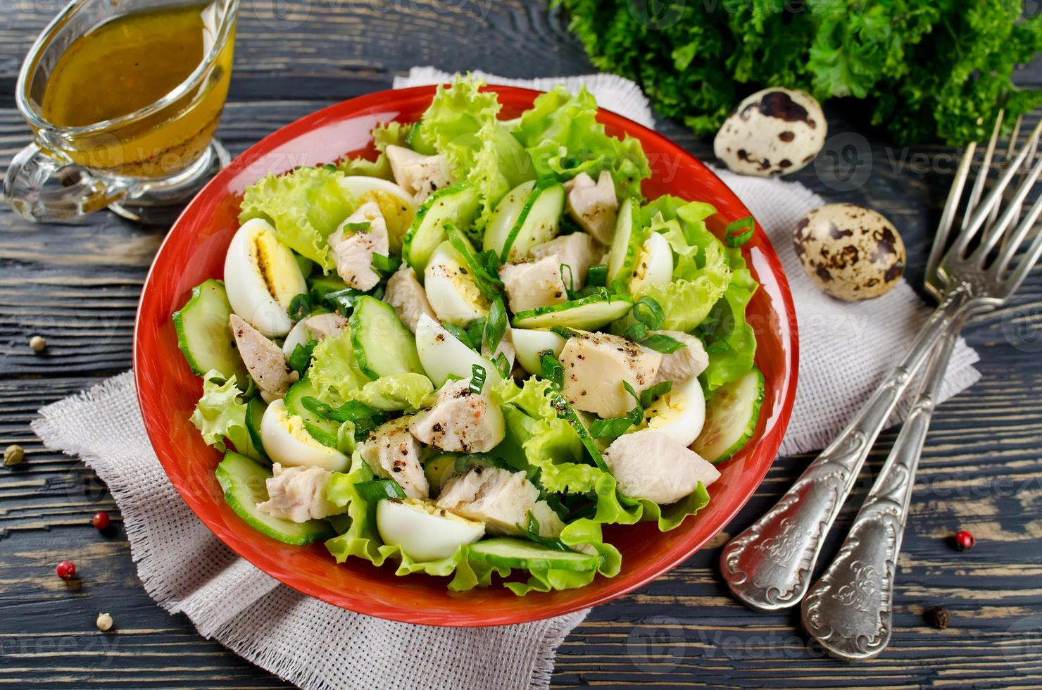 Vegetable salad with cod liver photo