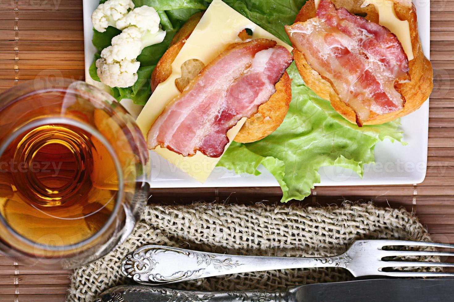 Serving breakfast toast with bacon and herbs photo