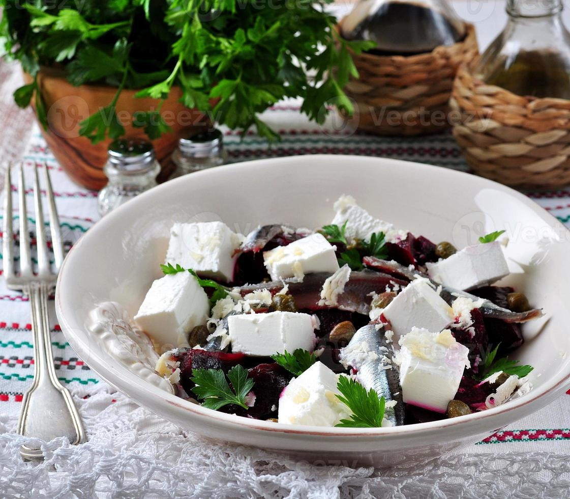 beet salad with goat cheese, anchovies, capers, parsley, olive oil photo