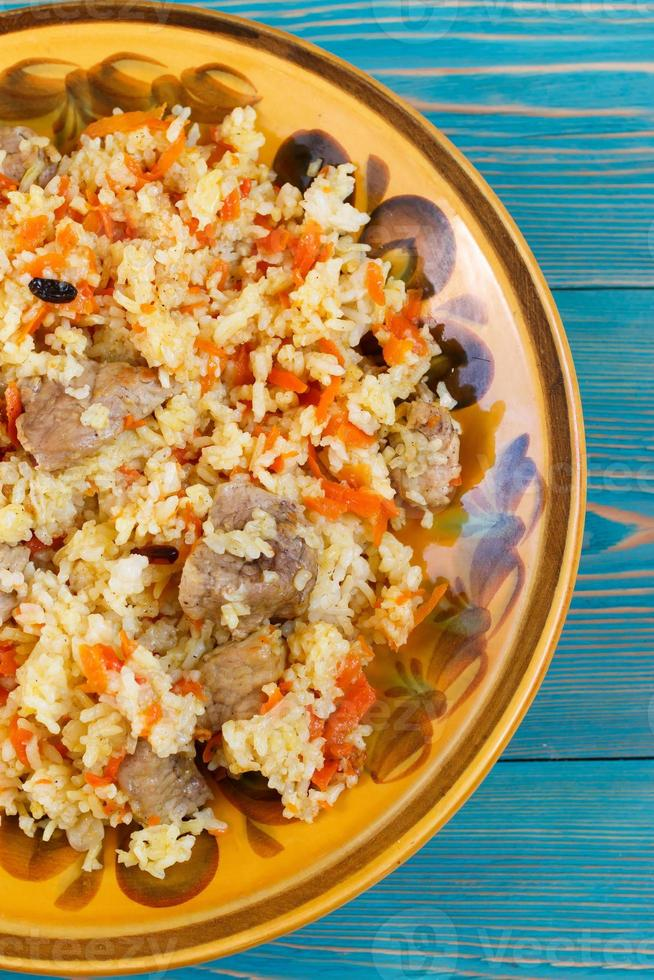 Uzbek pilaf, plov, pilaw with meat, carrot and berberries photo