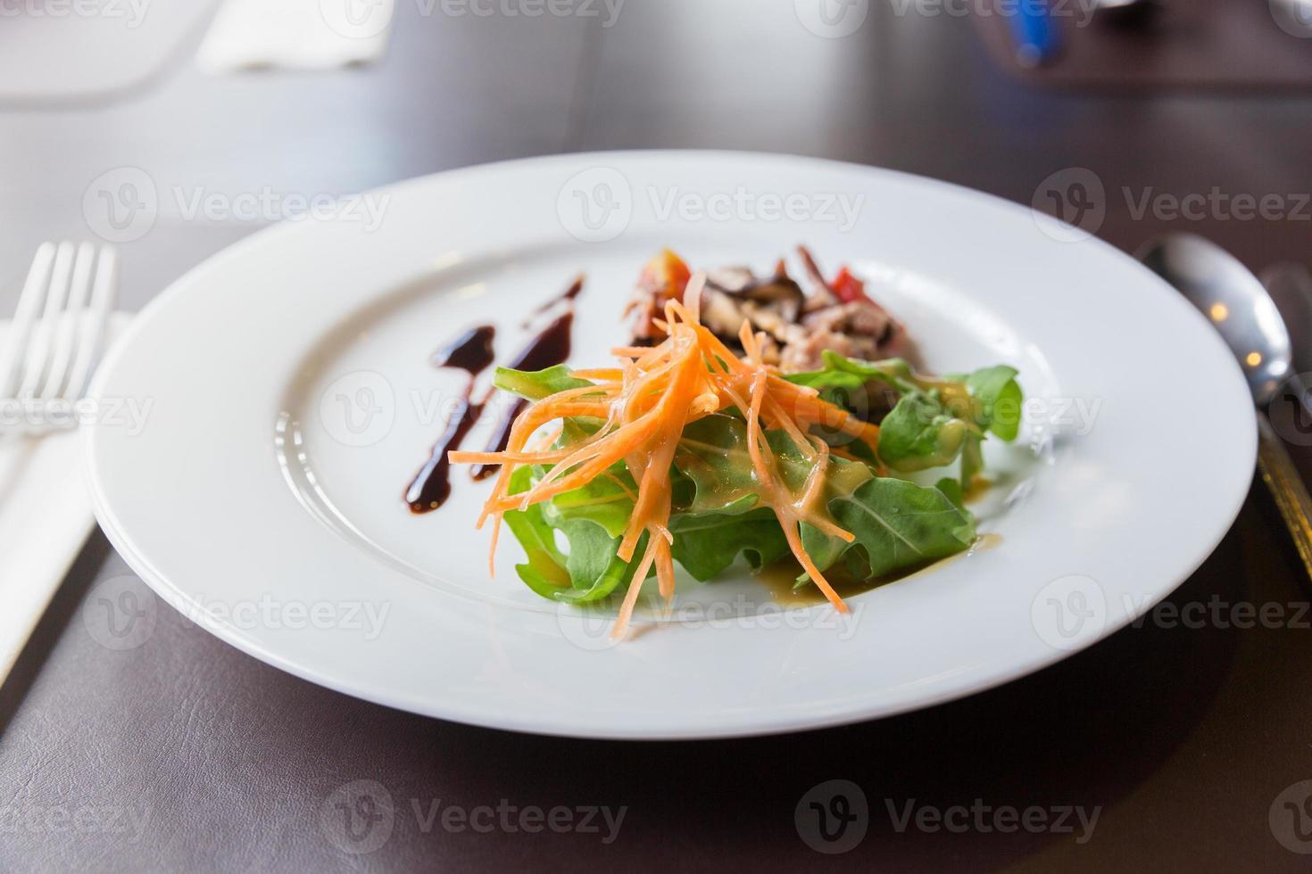 Apitizer mushroom salad mixed with pork photo