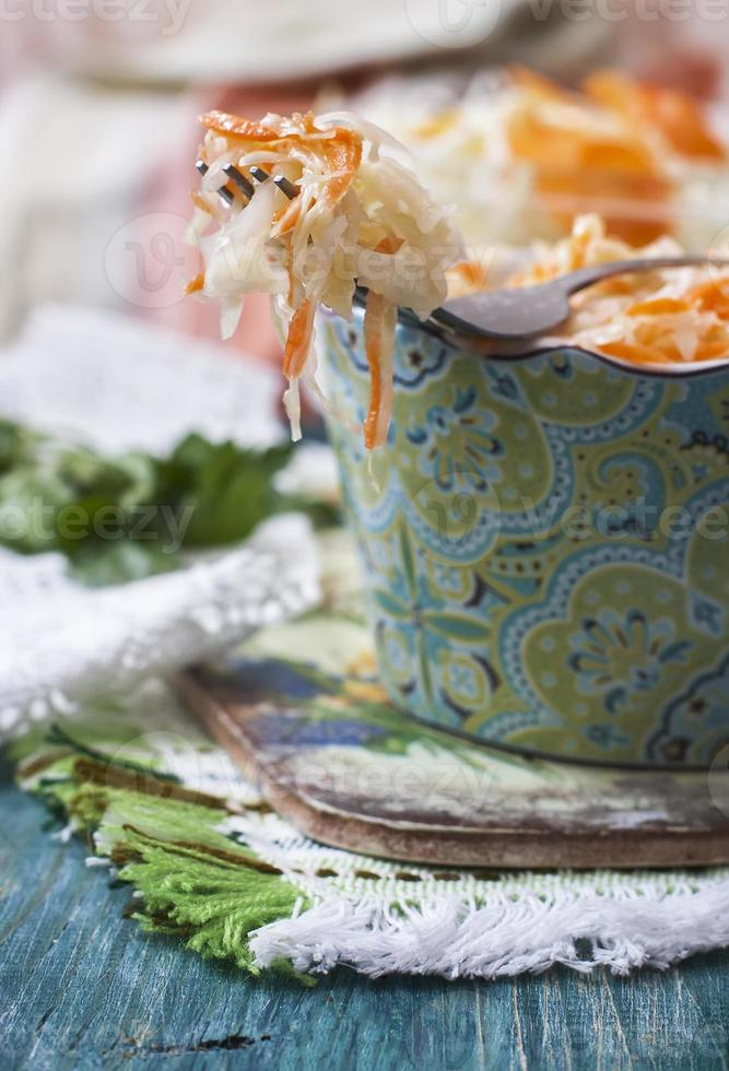 Sauerkraut or sour cabbage  in rustic style. Russian cuisine. photo
