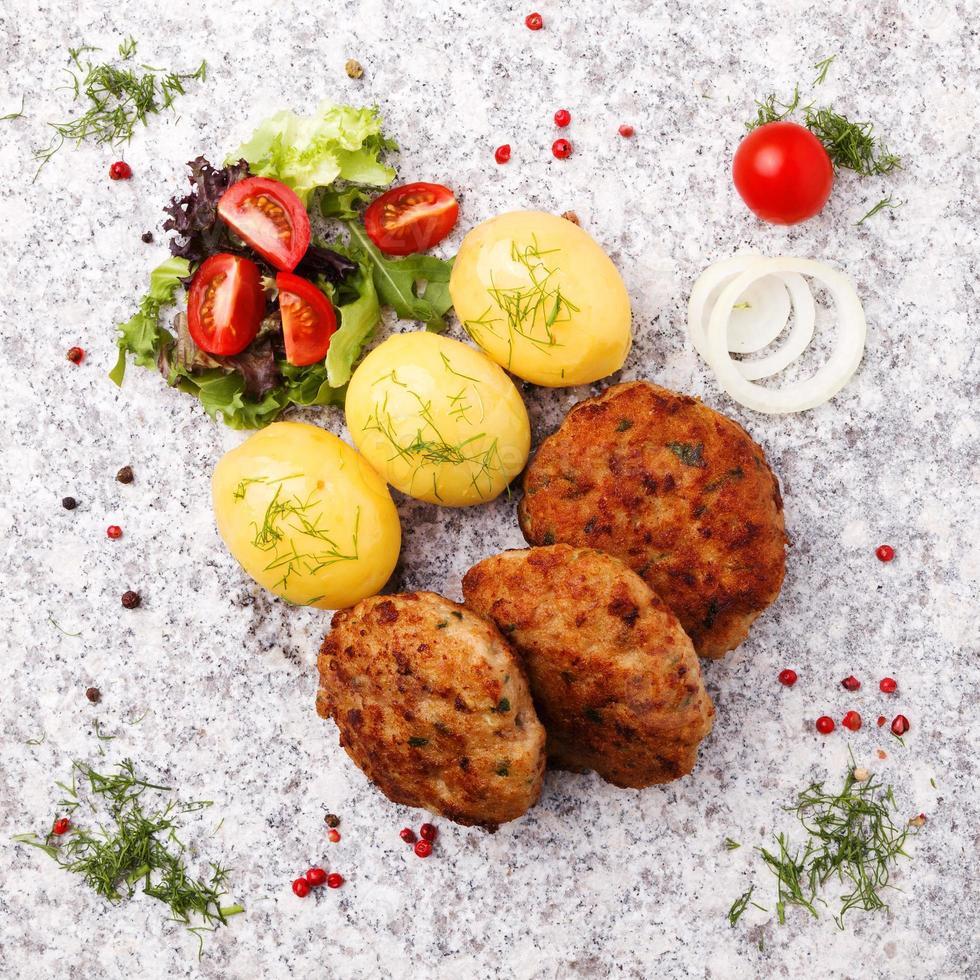 Fresh, homemade meatballs, served with tomato salad and new pota photo