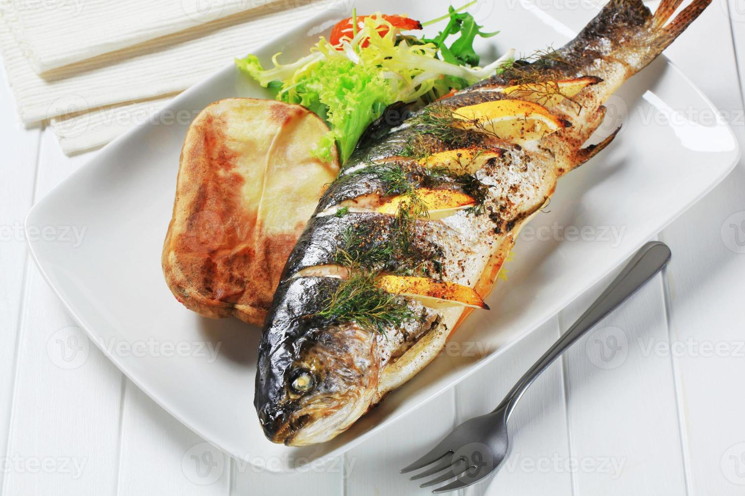Lemon dill trout with baked potato photo