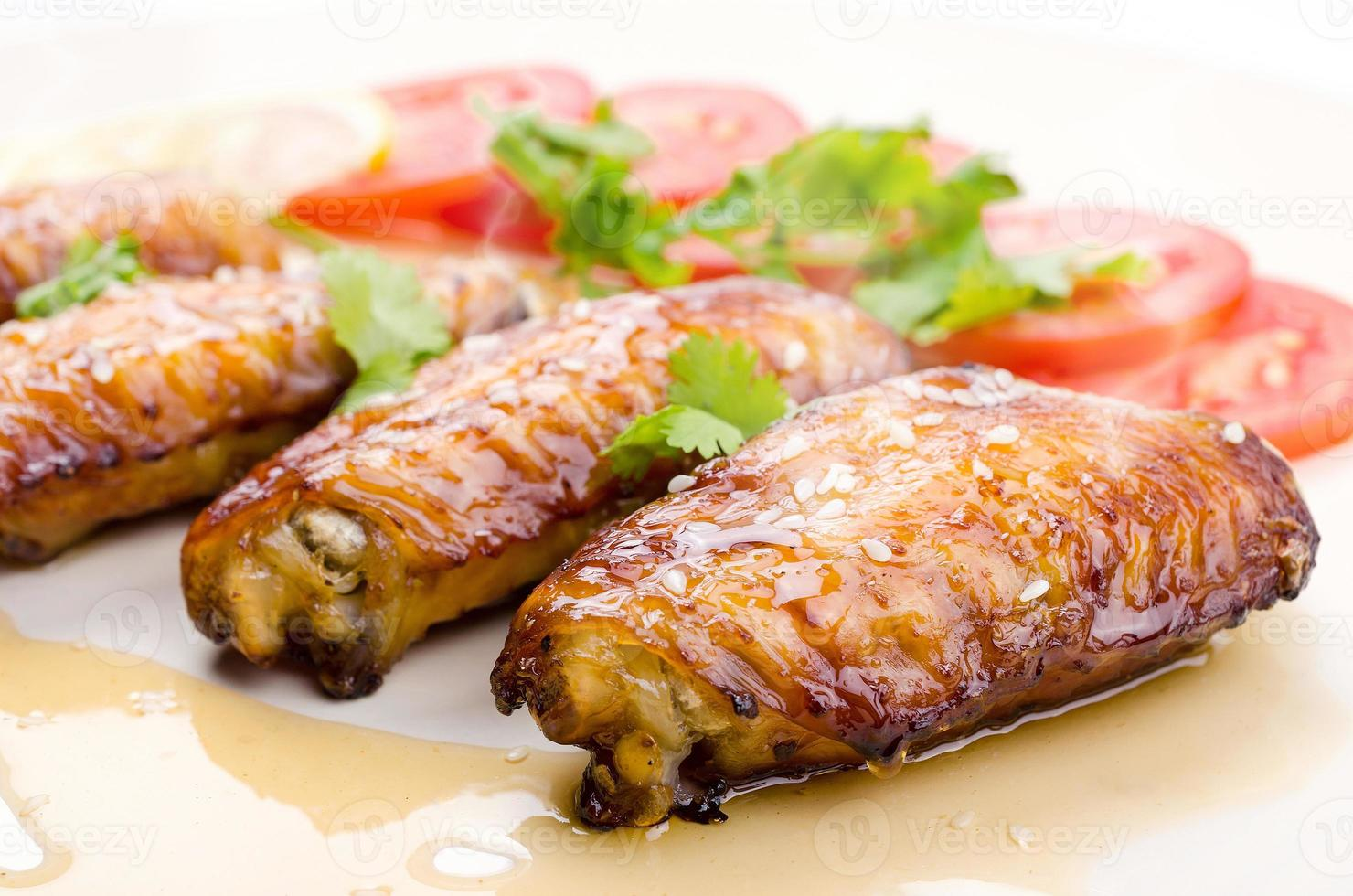 Grilled chicken wings and vegetables photo