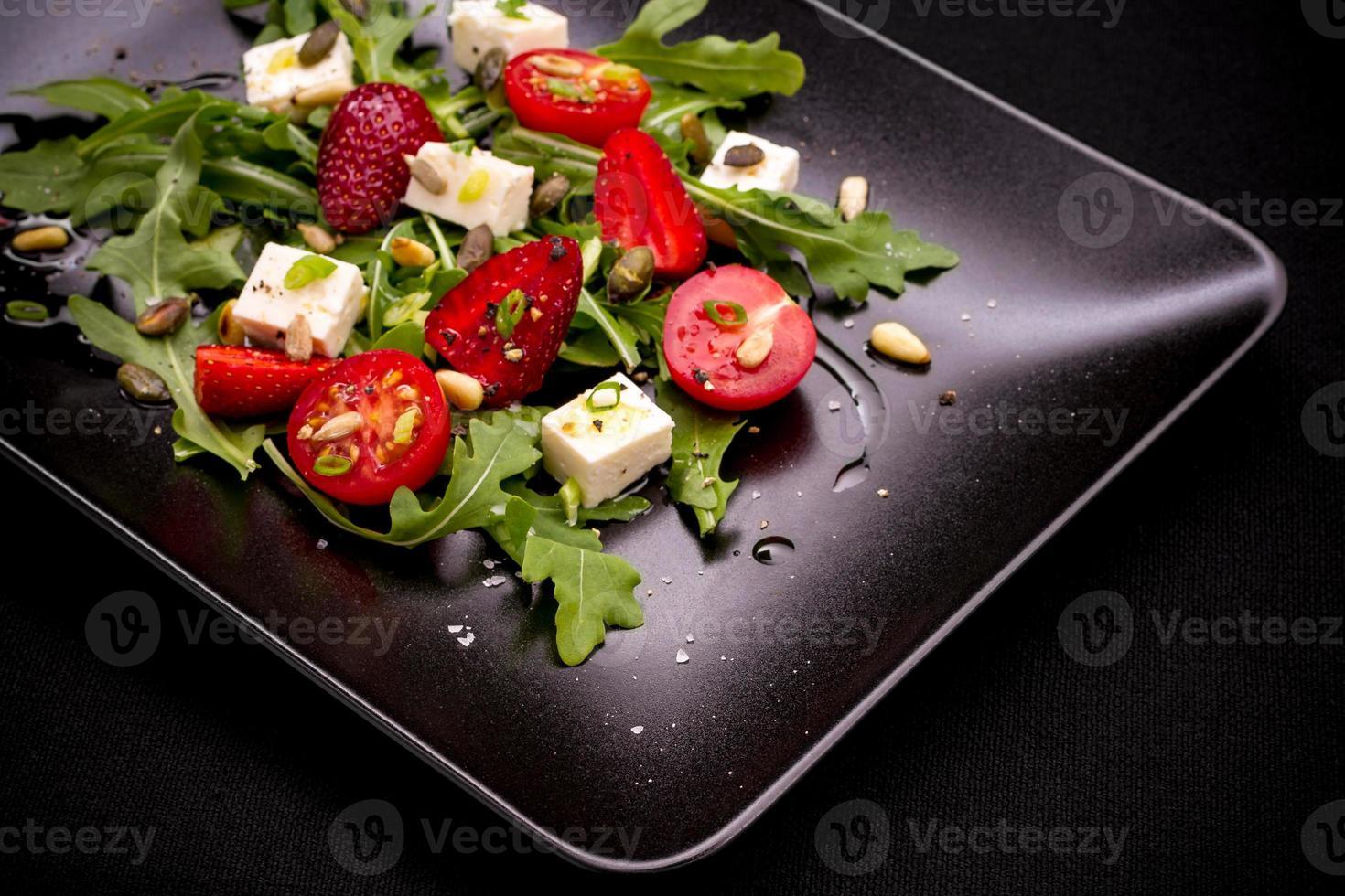 Strawberry tomato salad with feta cheese, olive oil photo