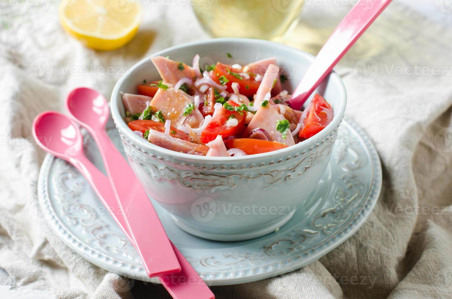 Salad with ham and tomatoes photo