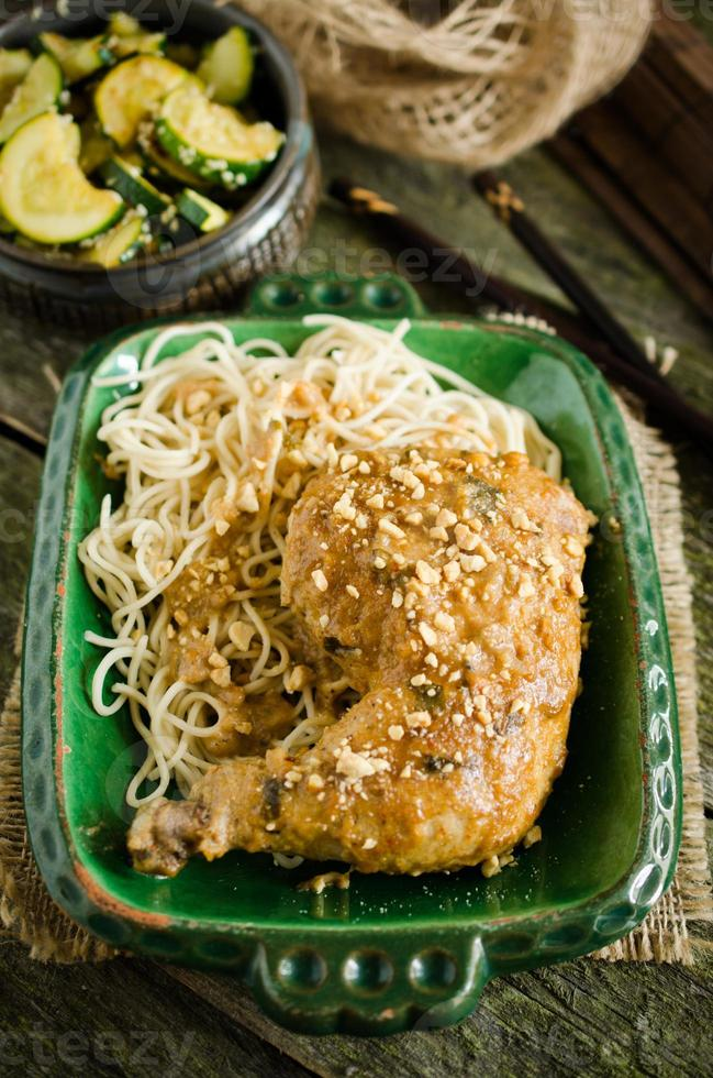 Chicken legs with peanut butter and chinese noodles photo