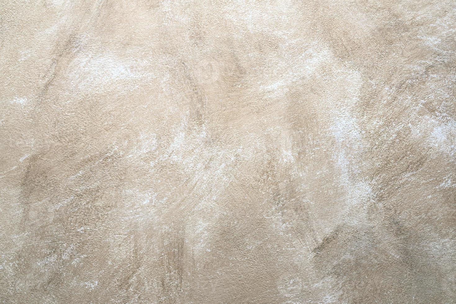 Fondo de pared beige abstracto de roca foto