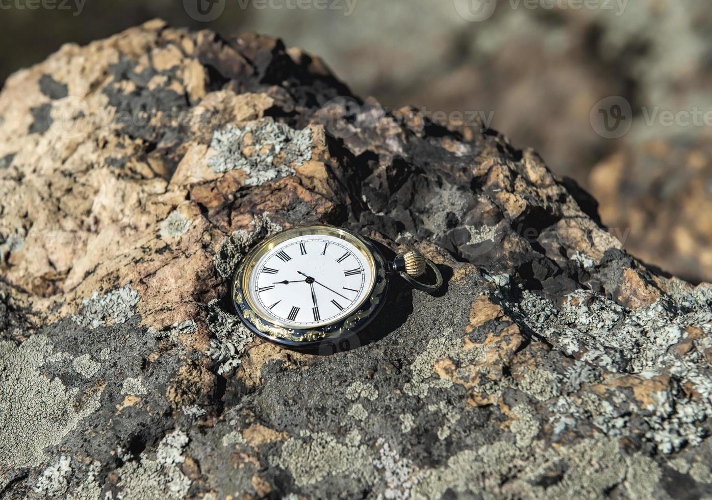 Watch on rocks photo