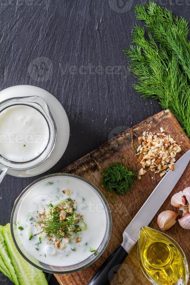 Tarator soup ingredients - cucumber, dill, walnuts, garlic, yogurt, oil photo