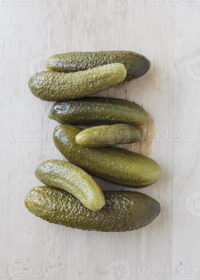 Pickle cucumber on wood plate photo