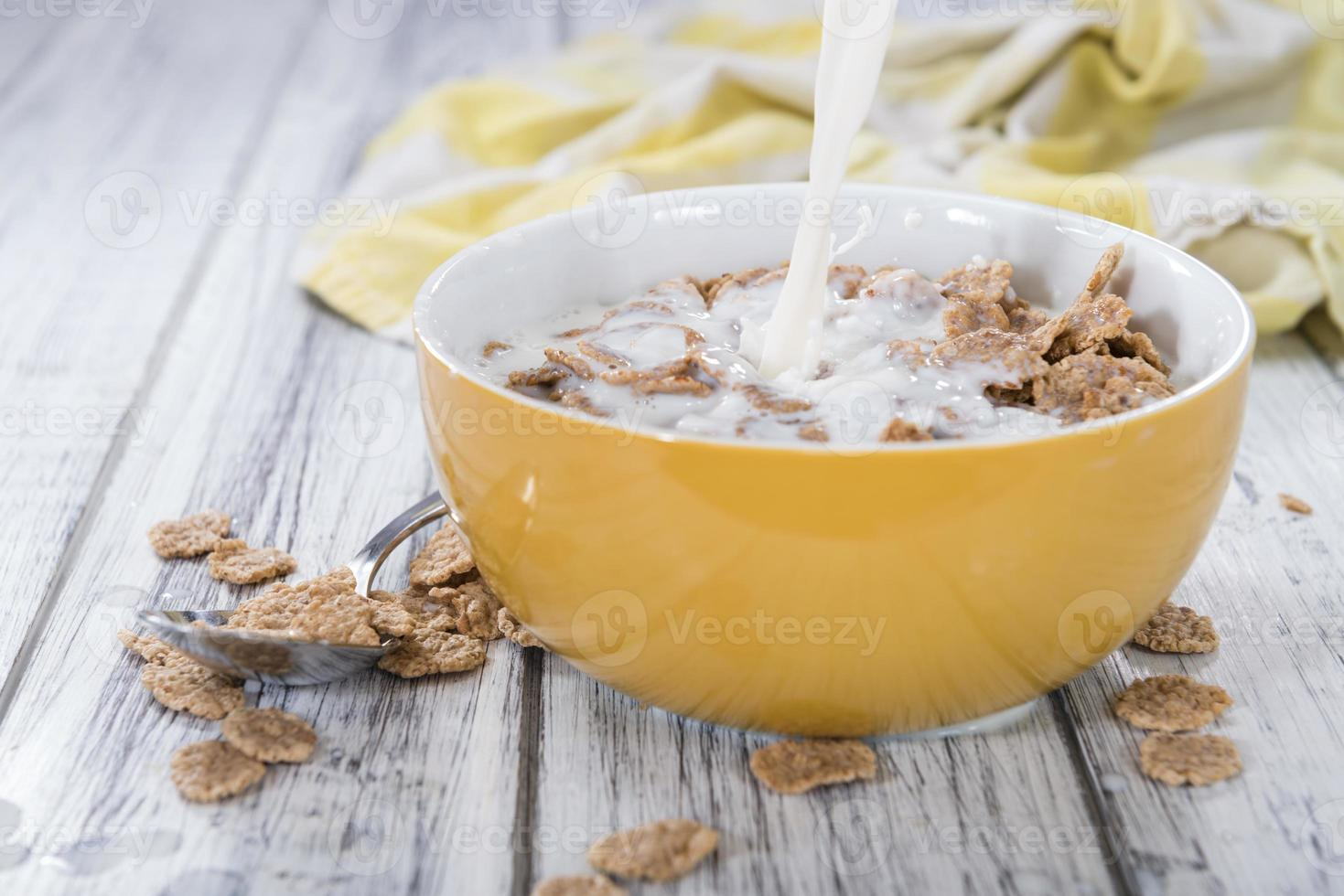 Pouring Milk on a portion of Cornflakes photo