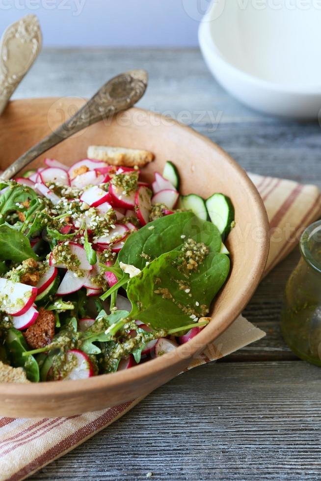 summer salad in rustic bowl photo