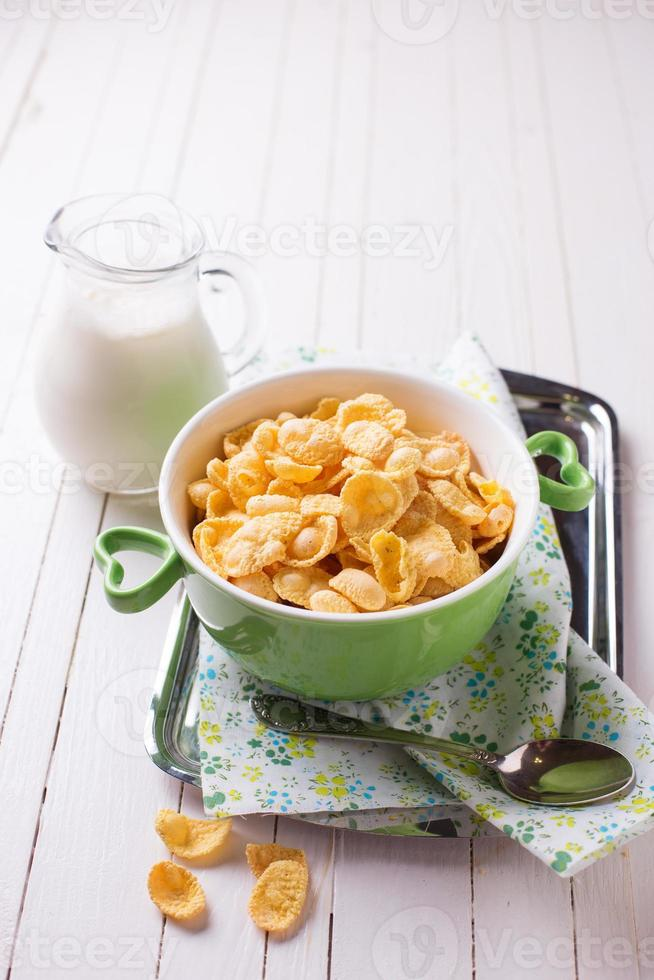 Cornflakes in bowl on table photo
