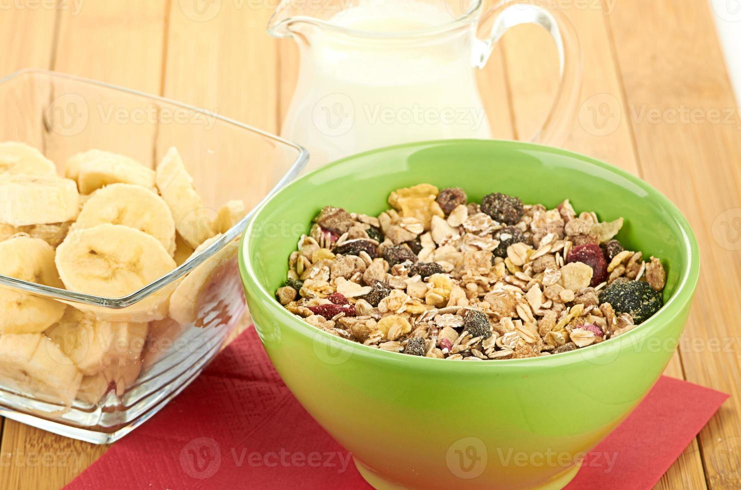 Delicious and healthy cereal in bowl with milk photo