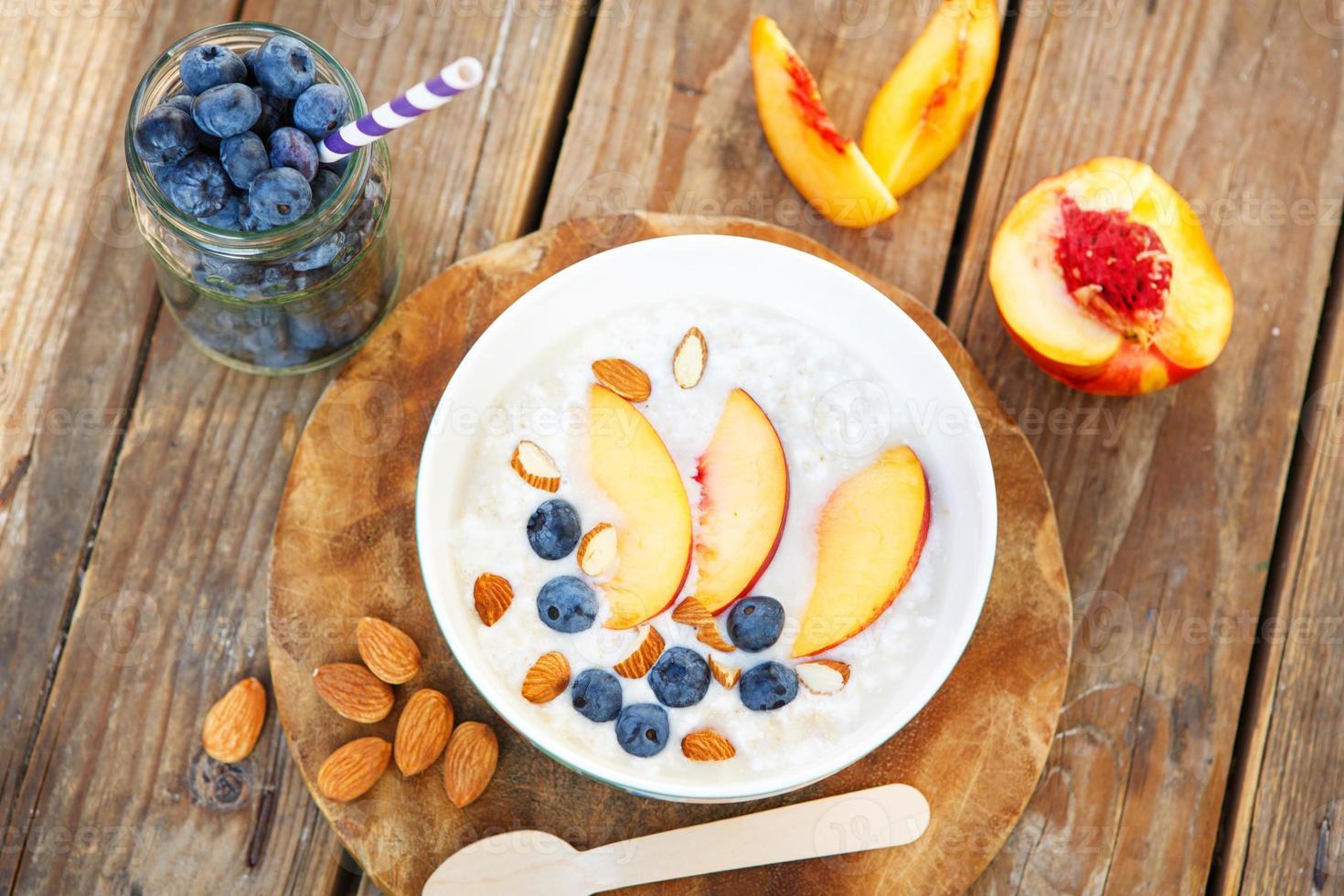 Granola with fresh organic blueberries, nectarines and almonds photo