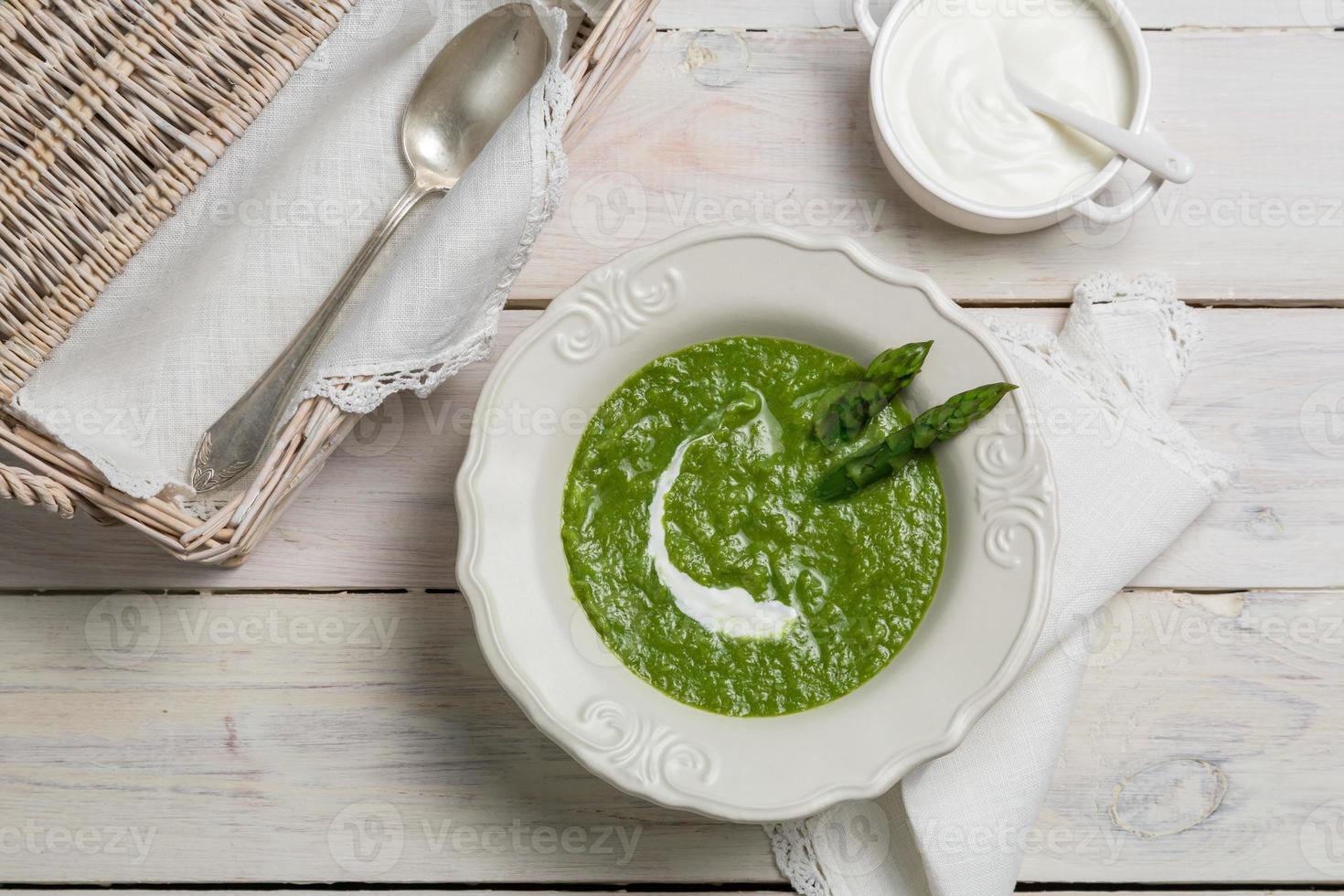 Asparagus soup with sour cream photo