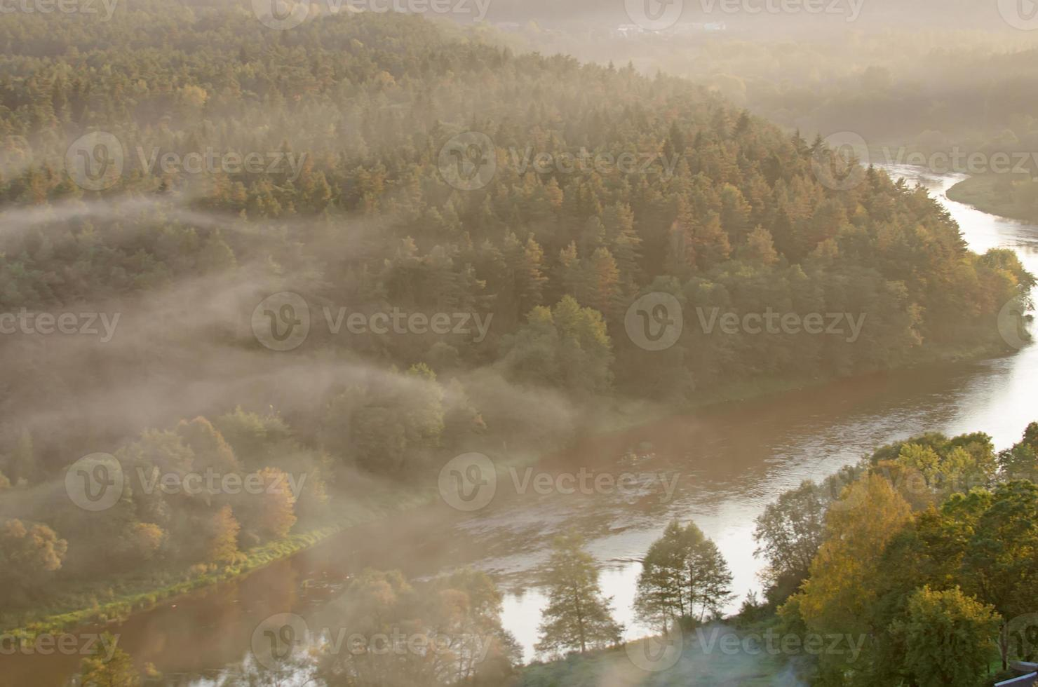 Fog over river photo