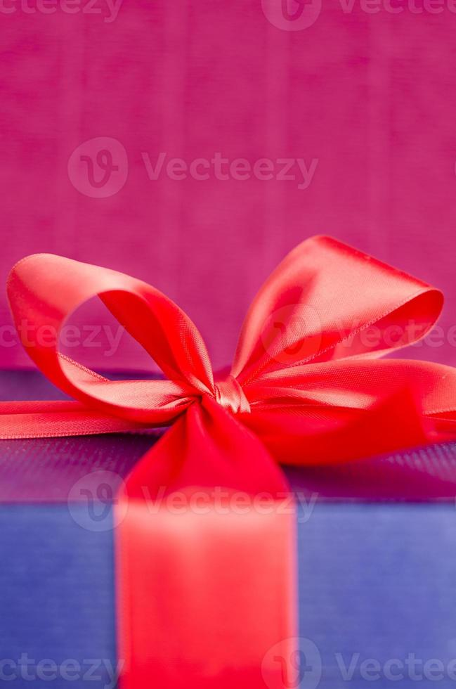 present box with red ribbon photo
