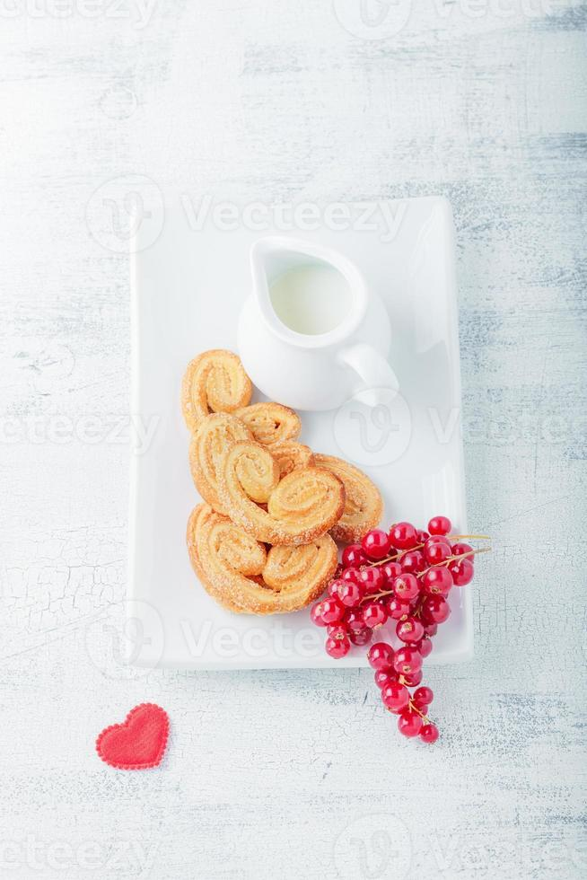 Heart-shaped biscuits with sugar and cinnamon photo
