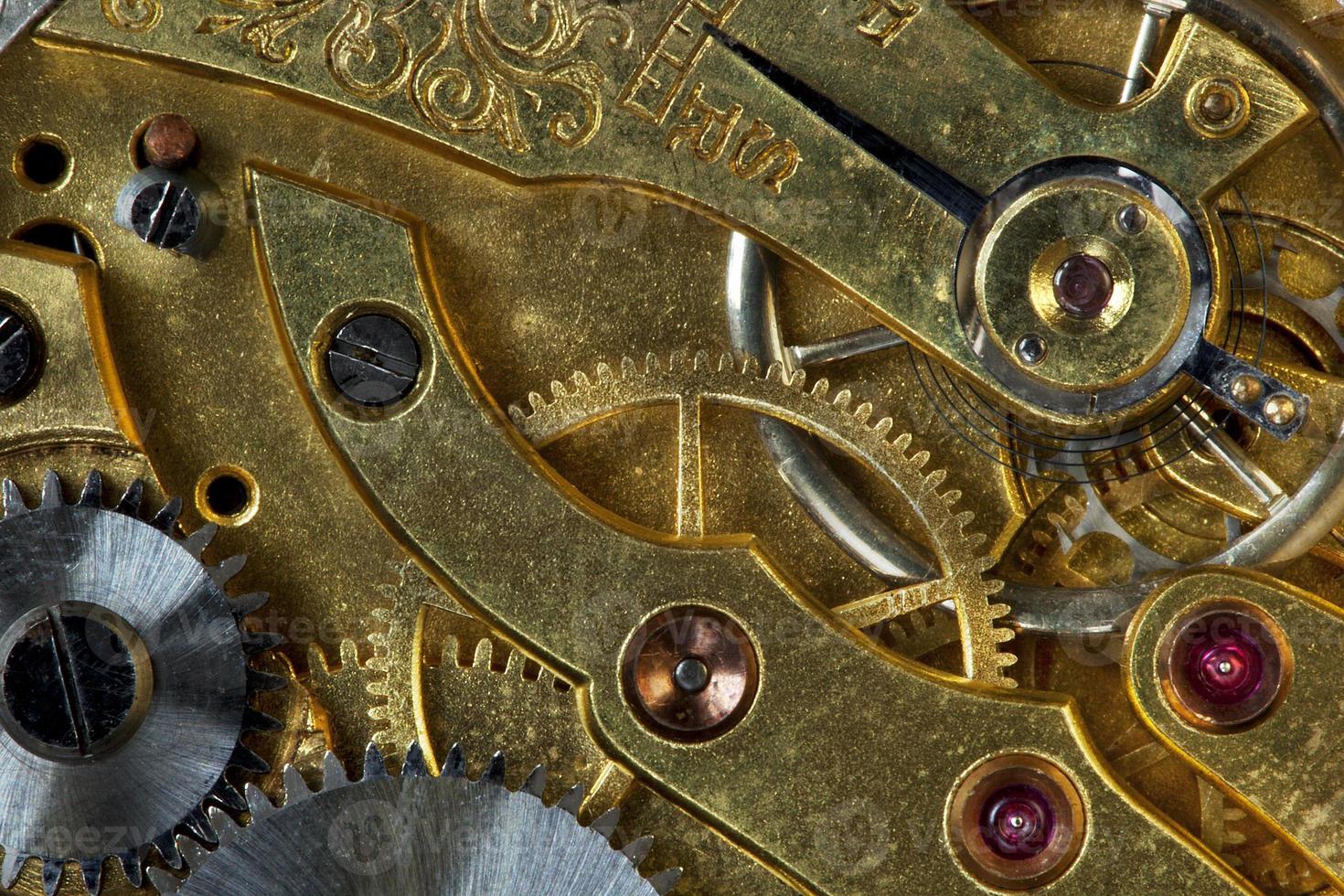 mecanismo del viejo reloj foto