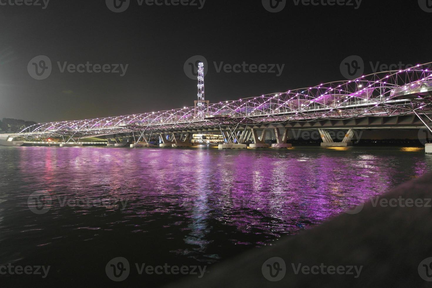 Helix Bridge in Singapore at night photo