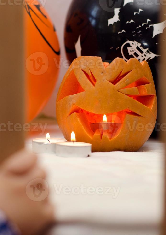 pumpkin with candles on Halloween photo