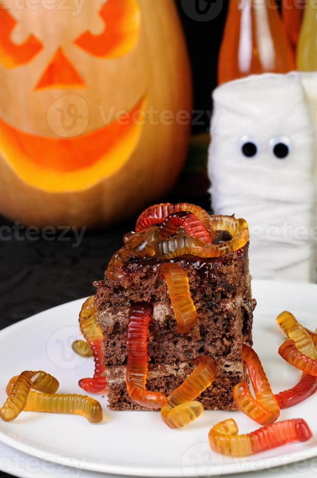 piece of chocolate cake with worms photo