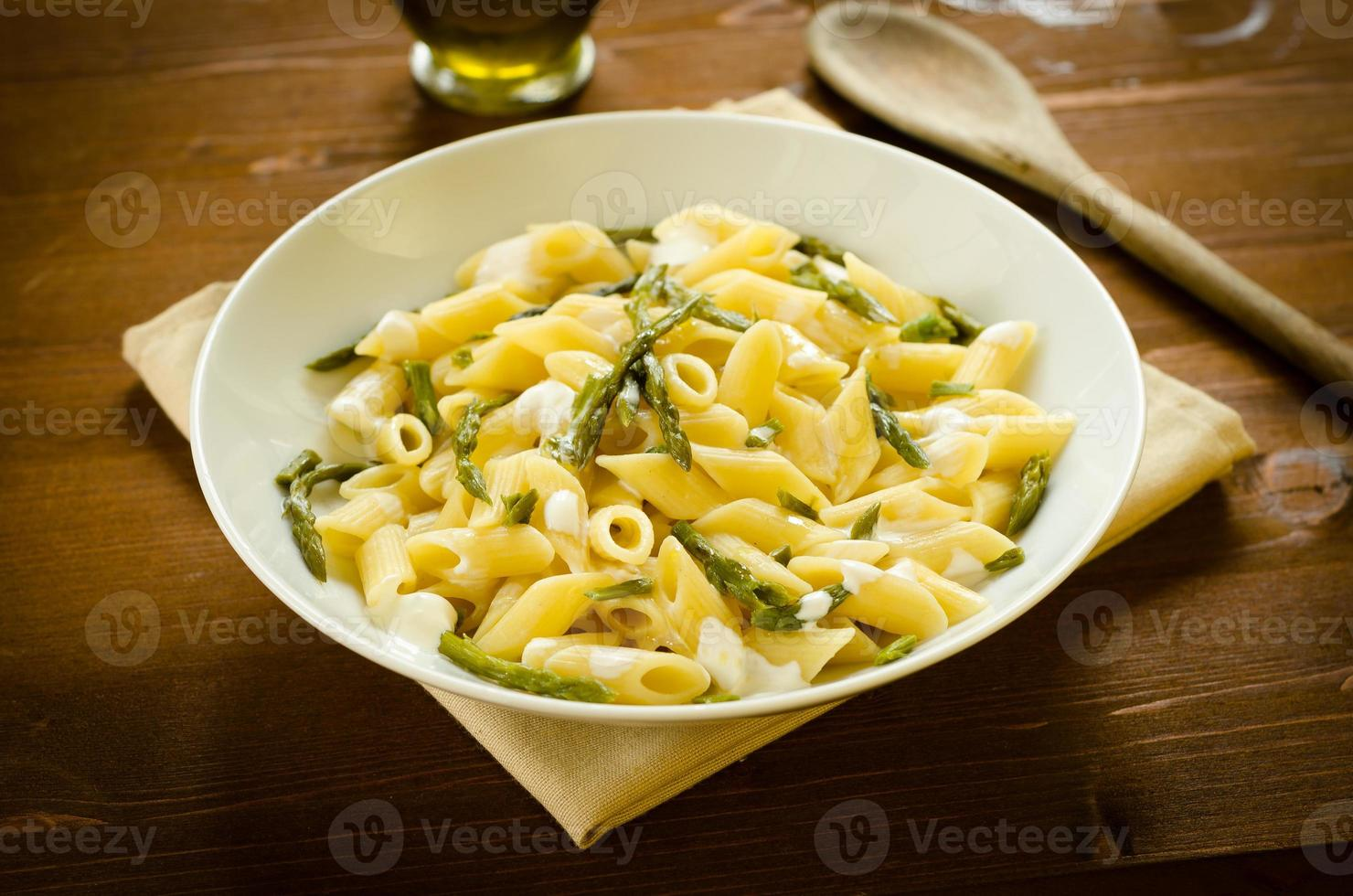 Penne with asparagus and cream photo
