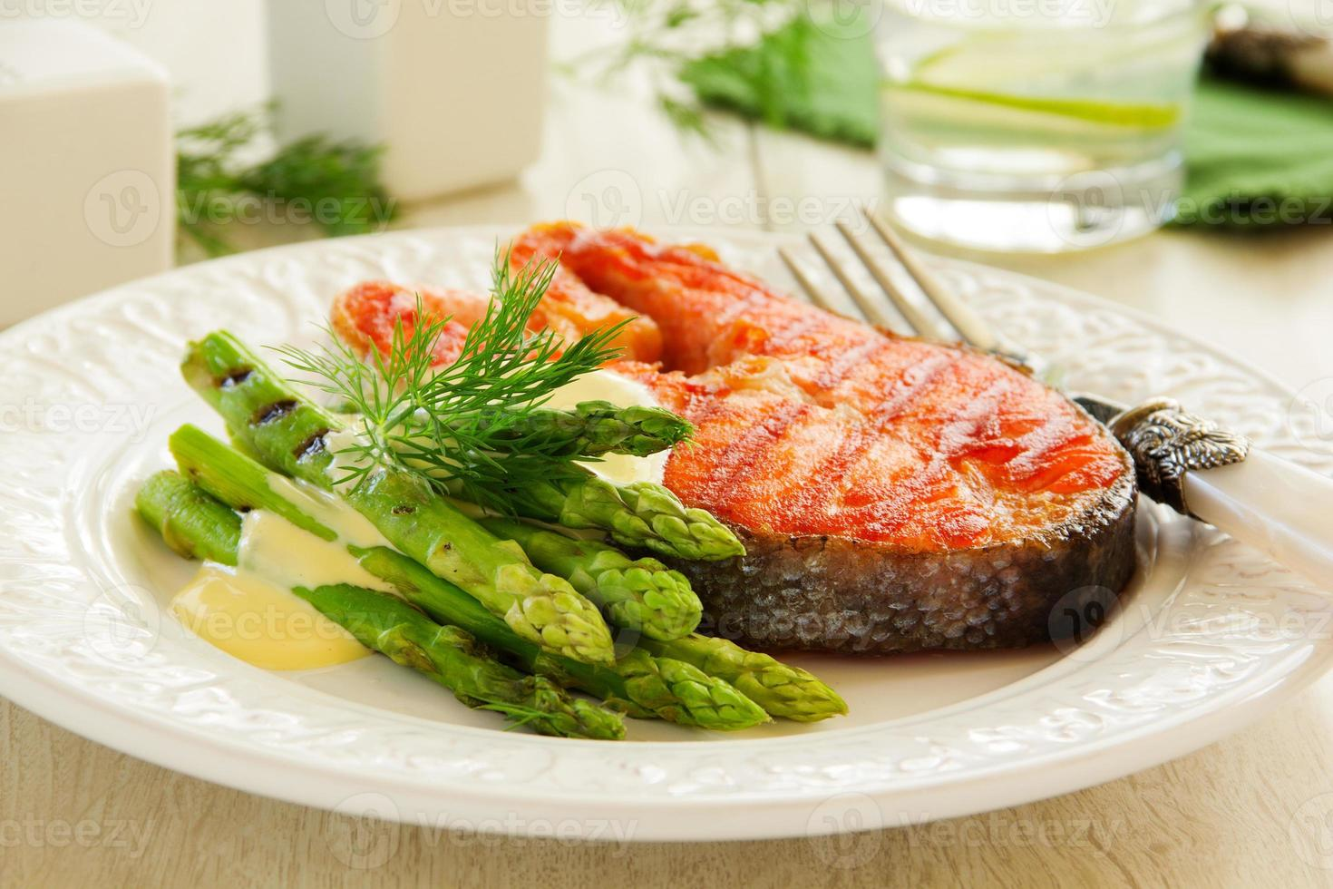 Grilled salmon steak with asparagus. photo
