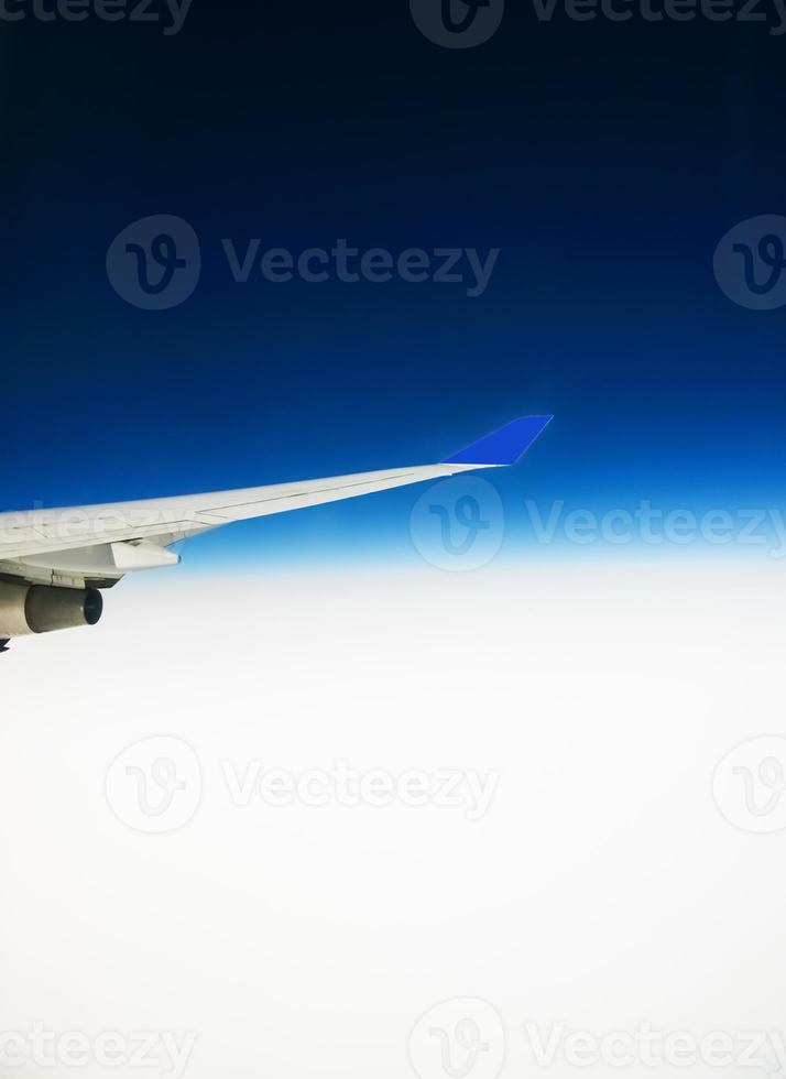 view of the wing of an airplane through the window photo