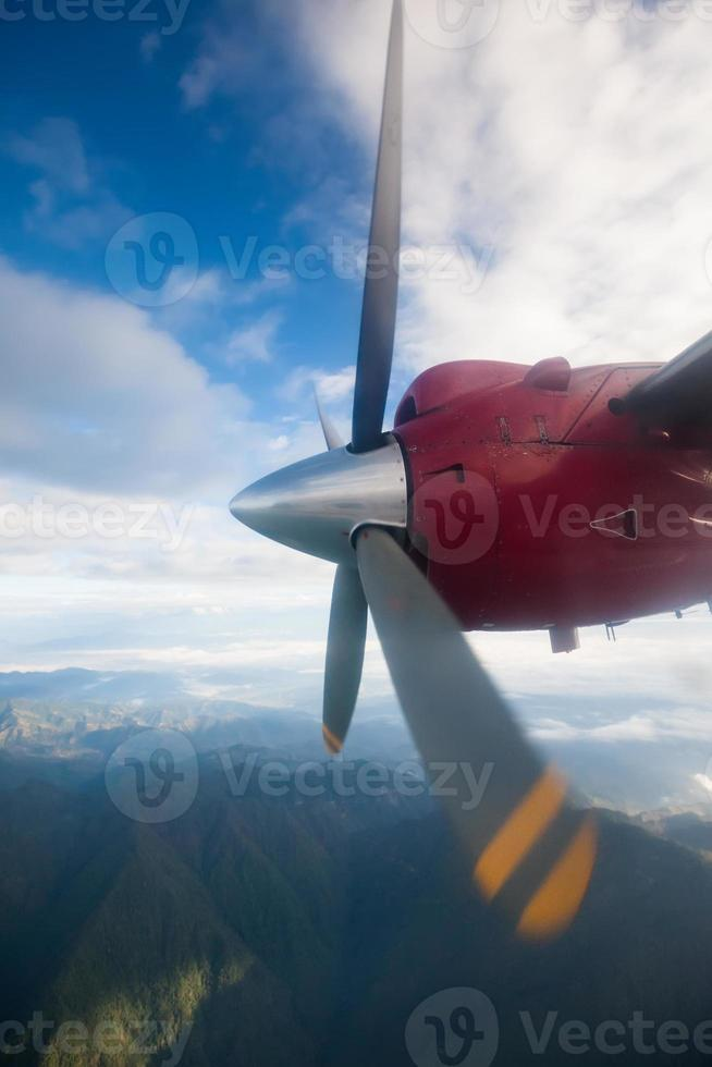 Propeller plane in air above Himalayas photo