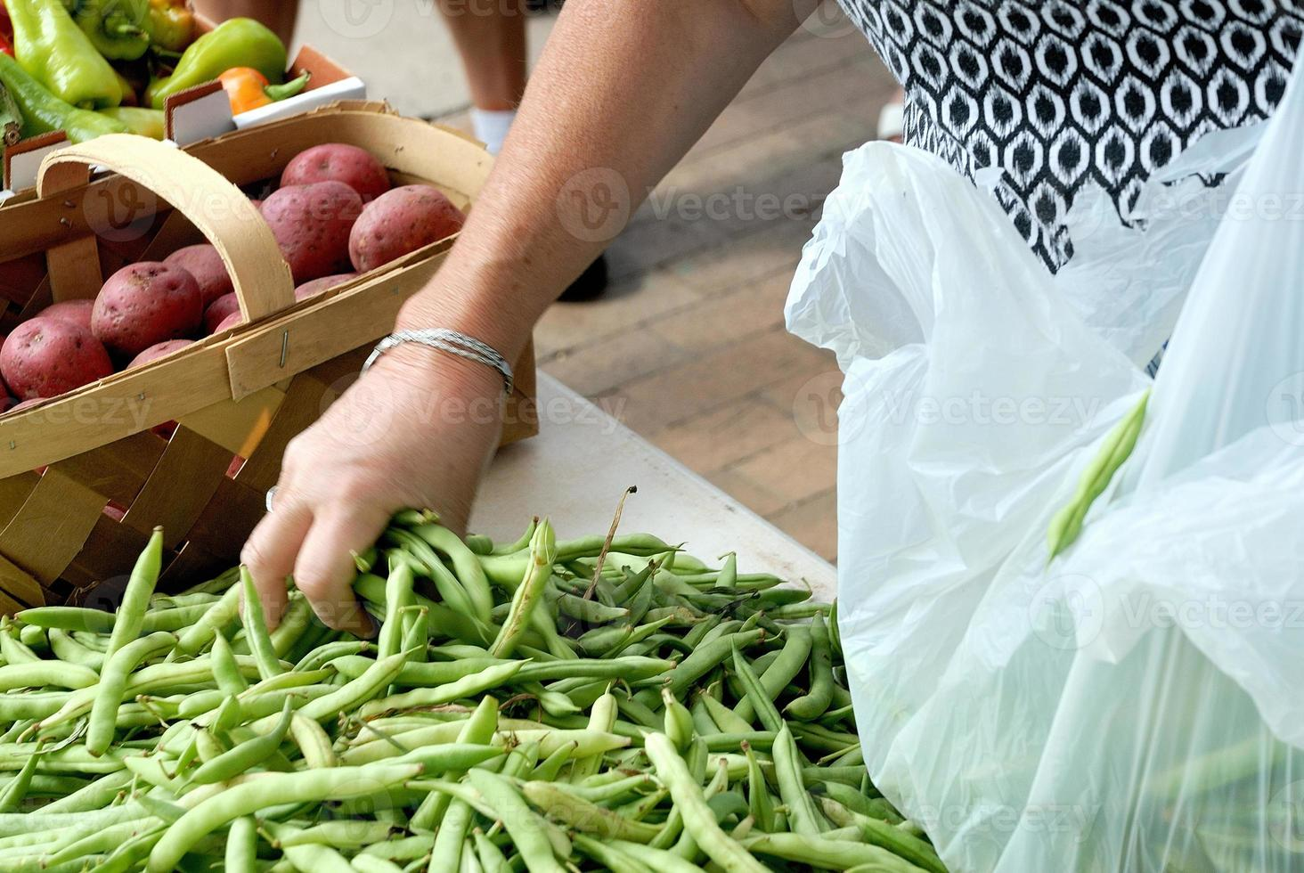 Fresh green beens being purchased photo