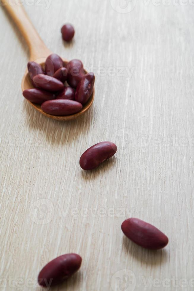 Red beans with wooden spoon photo