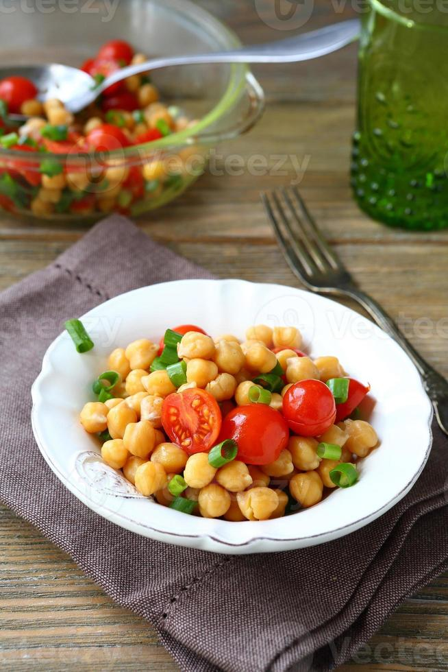 Salad with chickpeas and tomatoes photo