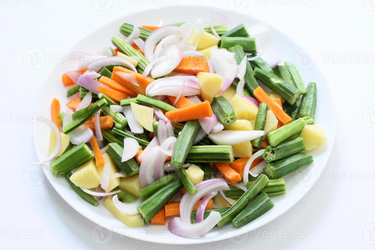 Mixed vegetables in a plate background photo