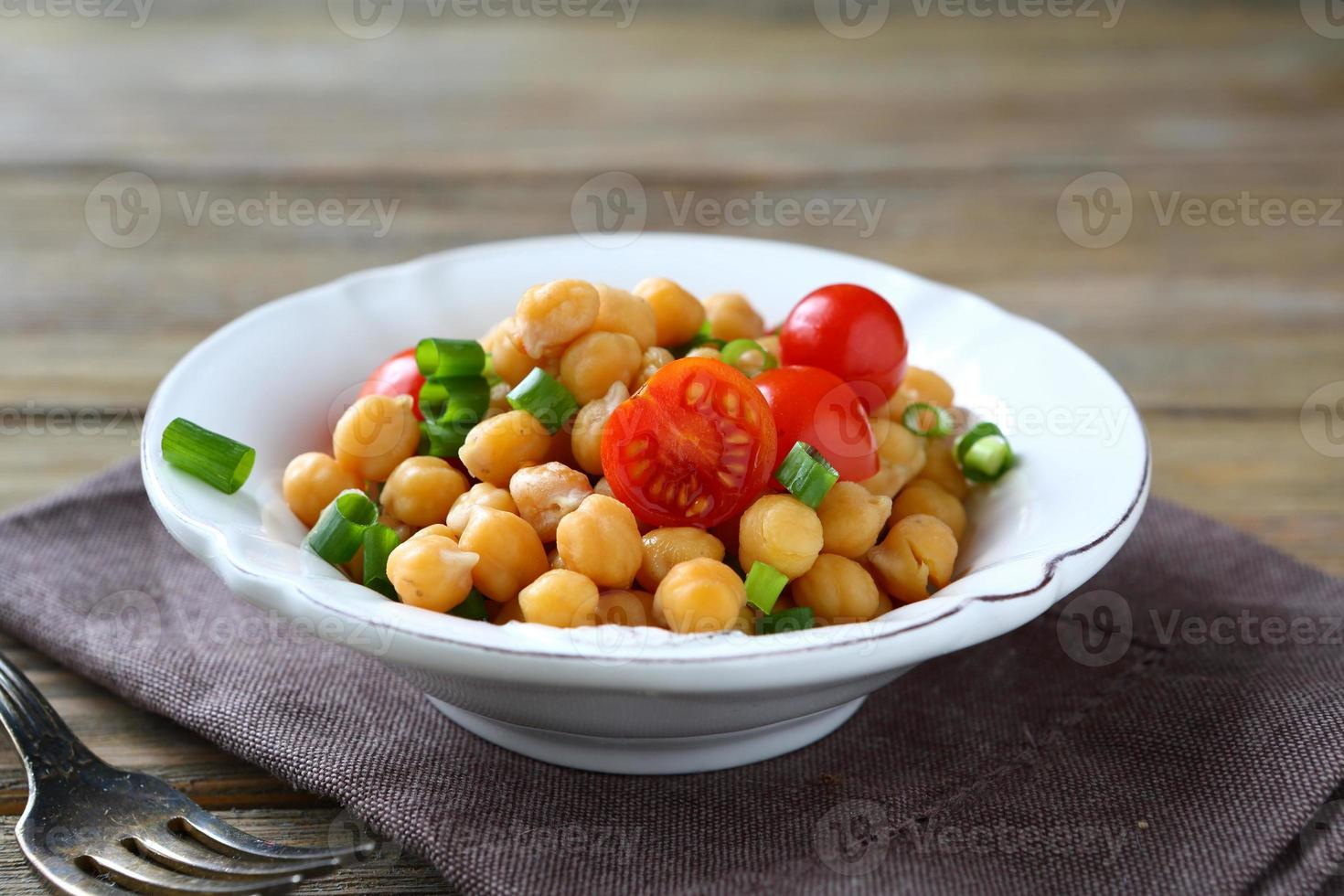 Chickpeas with vegetables in a bowl photo